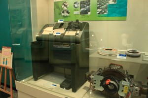 Mechanical punched card counter sorter machine and 9-track magnetic tape with tape drive in a glass case