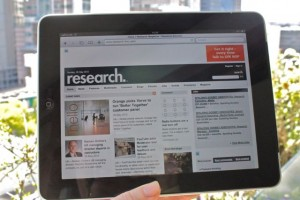 an Apple iPad displaying a website outdoors